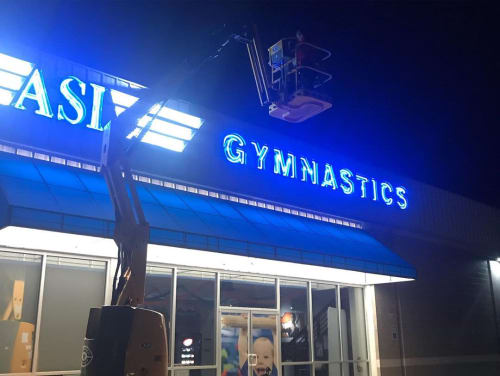 Signage by Houston Sign Lady seen at ASI Gymnastics - The Woodlands, Conroe - Exterior Signage