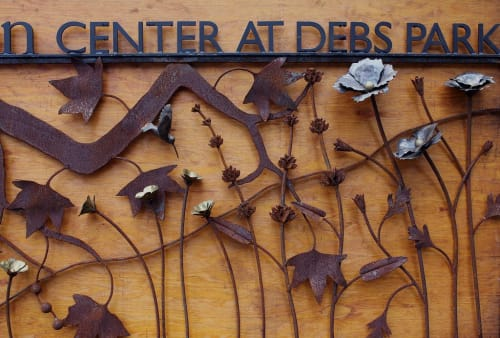 Signage by James Naish seen at Audubon Center at Debs Park, Los Angeles - Metal on Wood SIgnage