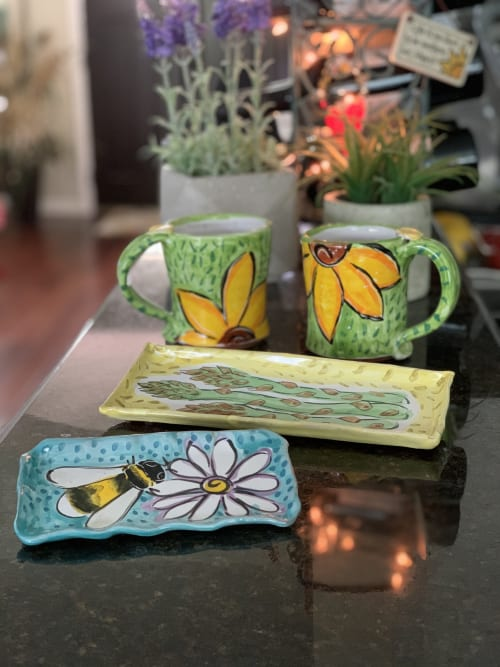 Cups by Clay Lick Creek Pottery seen at Private Residence - sunflower mugs and little trays