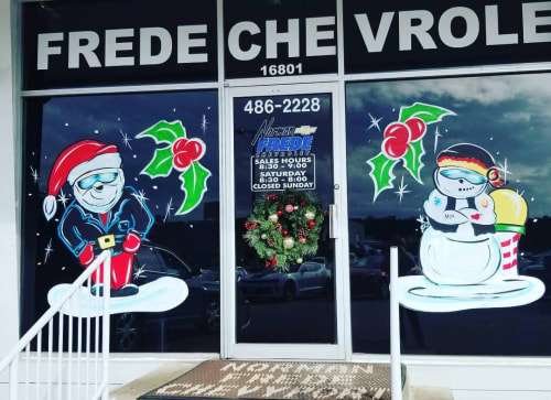 Art & Wall Decor by PaintSlingers seen at Norman Frede Chevrolet, Houston - Holiday Window Painting