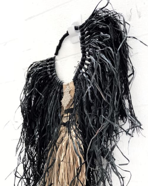 "Macrame Wall Hanging by roundnine9 seen at Private Residence, Honolulu - ""BEHATI"" Black and Natural Raffia Wall Necklace"