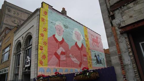 Murals by Elléna Lourens seen at Cork on Saginaw, Flint - Hearts and Hands
