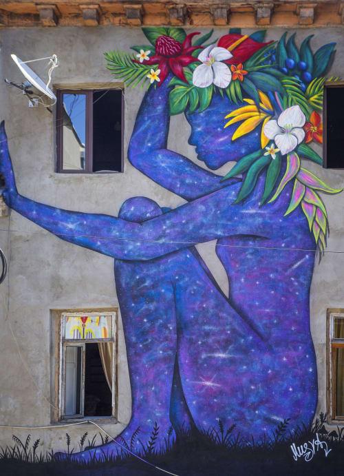 Murals by Musya Qeburia seen at 8 Egnate Ninoshvili St, T'bilisi - Cosmic Girl