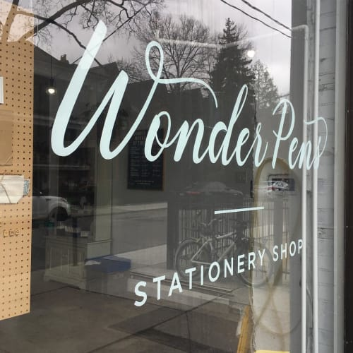 Signage by Christopher Rouleau seen at Wonder Pens, Toronto - Wordmark & Window sign