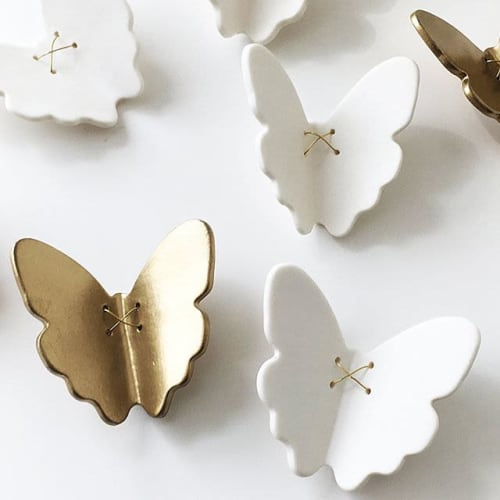 Art & Wall Decor by Elizabeth Prince Ceramics seen at Private Residence, Atlanta - Porcelain butterfly group wall art installation. Textured modular flexible wall sculpture