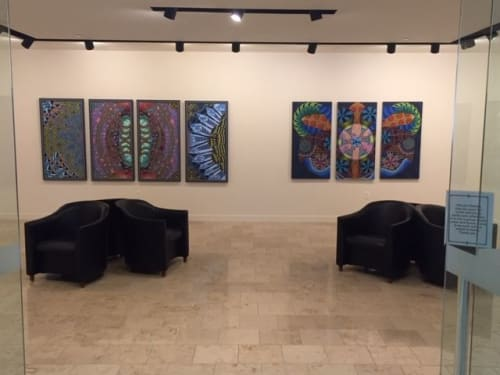 Paintings by Nancy Hayes Art seen at Bentley University, Waltham - Germinate, painting on left, as seen at the RSM Gallery, Bentley University March/April 2019