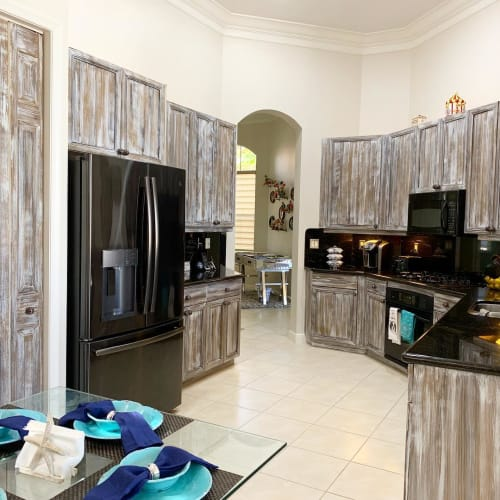 Furniture by Art Turquoise Murals, Wall Decoration, Art on canvas by Margarita Streinesberger seen at Private Residence, Jupiter - Driftwood cabinets finish