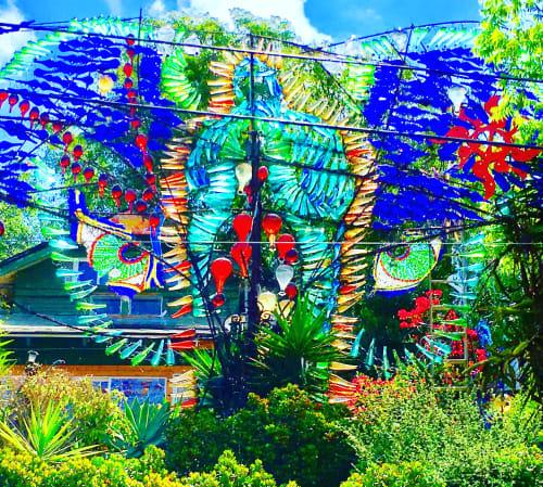 Public Sculptures by RandylandLA seen at Randyland, Los Angeles - Giant Glowing  Virgin Between Green Giant Glowing Eyes