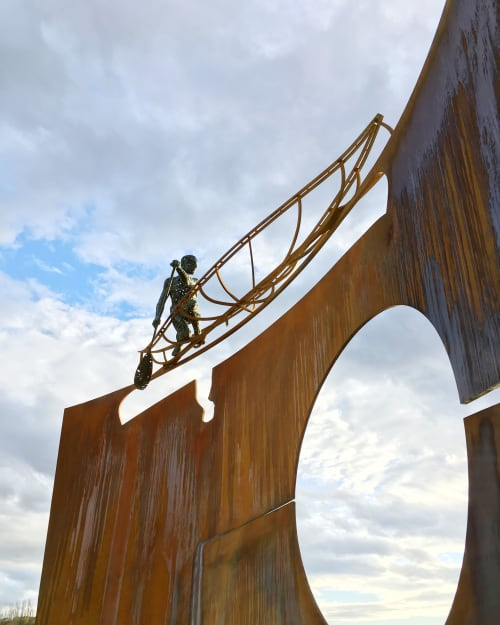 Public Sculptures by David Robinson seen at Macdonald Drive, Fort McMurray - Reflections on the River