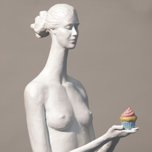 Sculptures by Corbin Bronze seen at Country Club Plaza, Kansas City - Sarah with Cupcake