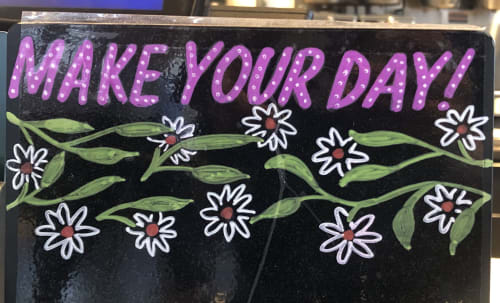 Signage by YQ Design seen at Starbucks, Queens - Make your day