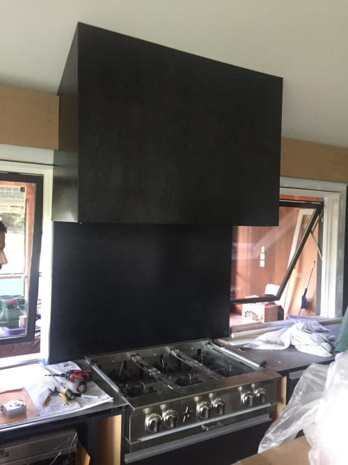 Appliances by 21B Design seen at Private Residence, Old Lyme - Blackened steel  stove hood