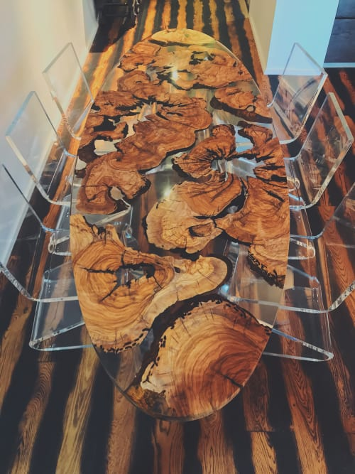 Tables by Holz Wood Shop seen at Private Residence, Fisher Island - Olive Wood Epoxy Table