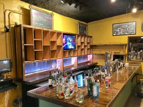 Furniture by Rustic River Creations seen at Puckett's Grocery & Restaurant - Downtown Franklin, Franklin - Custom Rear Bar