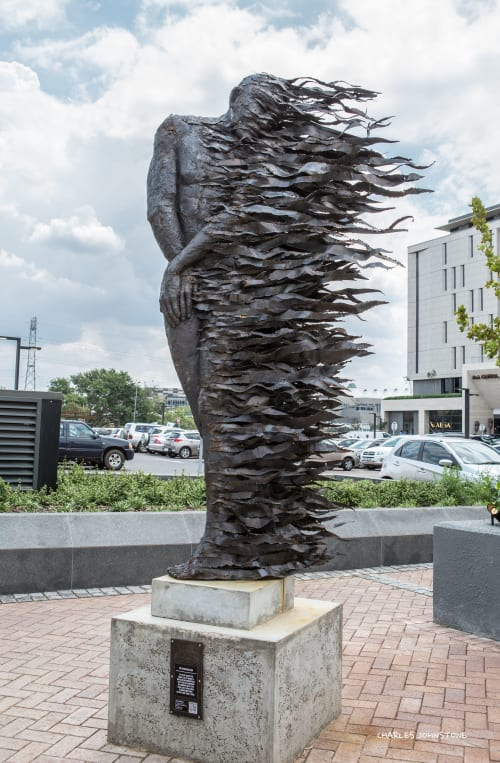 Public Sculptures by Anton Smit seen at Menlyn Maine Central Square, Pretoria - The Burning Man