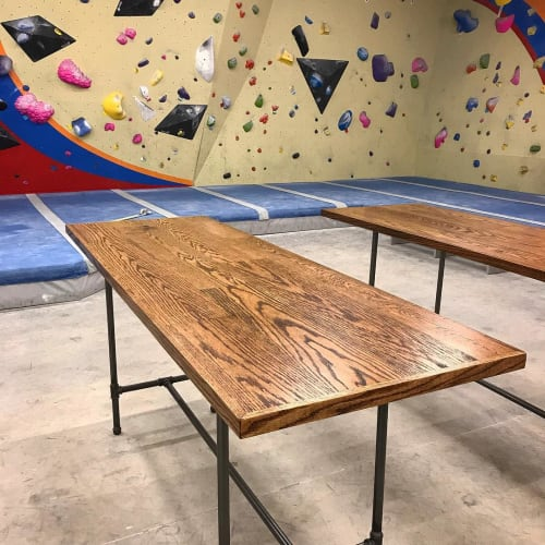"Tables by Scurfield WoodWorks seen at Stone Summit Climbing and Fitness Center, Atlanta - ""Rust-Dustrial"" Tables"
