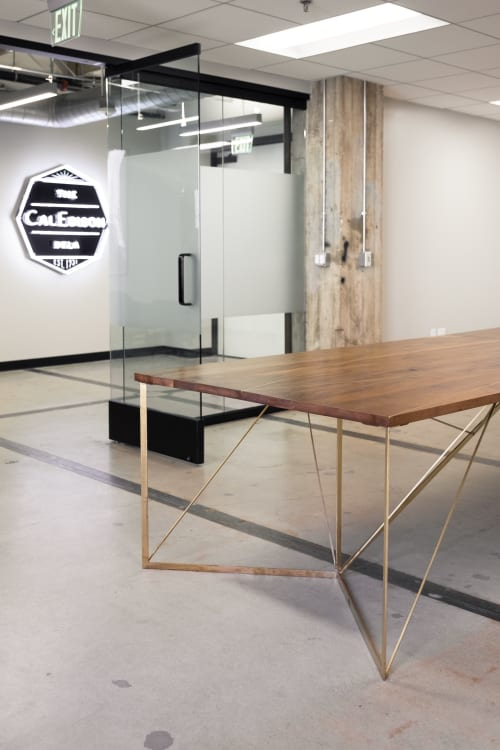 Tables by Base Collaborative seen at The CALEDISON DTLA, Los Angeles - Brass and Wood Table