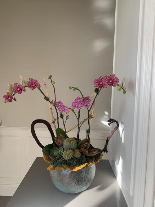 Floral Arrangements by Fleurina Designs seen at LUNA Mexican Kitchen - The Alameda, San Jose - Vibrant orchid arrangement