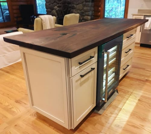 Tables by Creation Therrien seen at Private Residence - Walnut Slab Kitchen Island