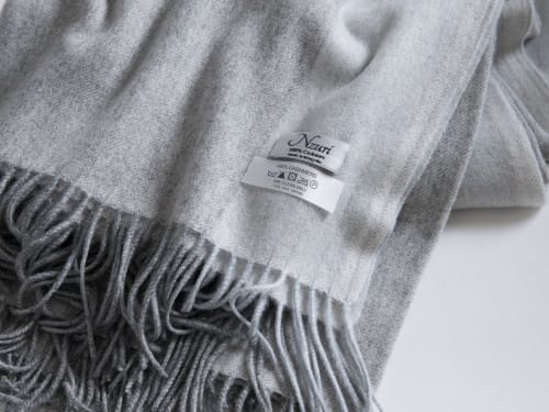 Linens & Bedding by Nzuri Textiles seen at Creator's Studio, Nevada City - Biarritz Cashmere Throw