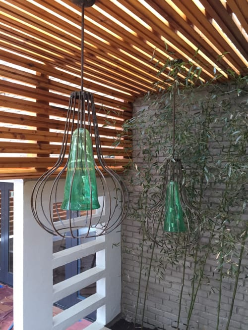 Pendants by Mark Americo Wentz seen at Private Residence, Dunwoody - Blown Glass and steel pendants