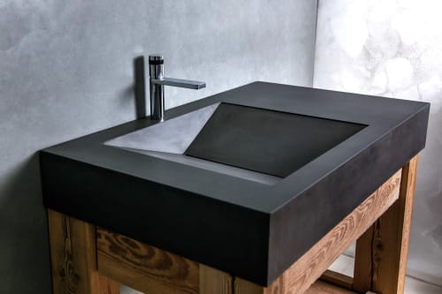 Water Fixtures by Woven 3 Design seen at Creator's Studio, Whitefish - Charcoal colored concrete vanity top with sink