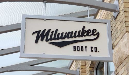 Signage by Brandon Minga seen at Milwaukee Boot Company, Milwaukee - Branded signage