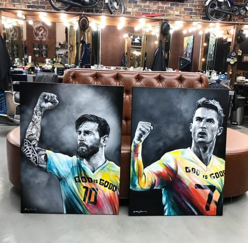 Paintings by Anthony Hernandez Art seen at The Spot Barbershop - Gables, Coral Gables - Lionel Messi and Cristiano Ronaldo