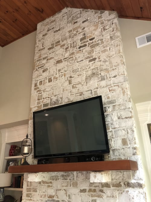 Wall Treatments by EMILY POPE HARRIS ART seen at Private Residence, Big Canoe - Custom Whitewash on Stone Fireplace