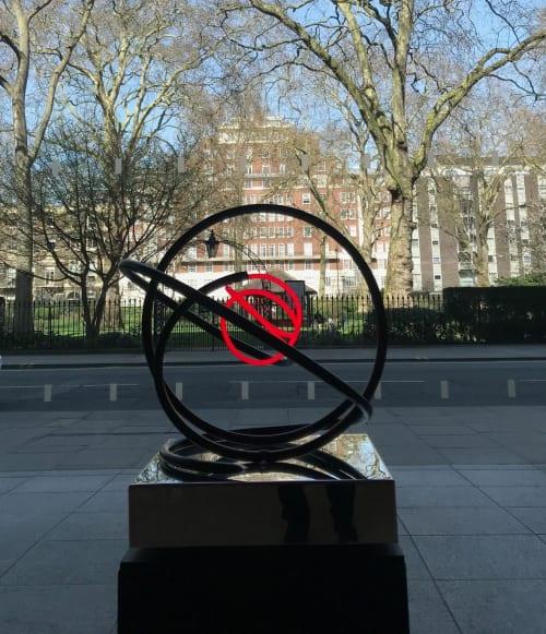 Public Sculptures by Mark Beattie MRSS seen at 40 Portman Square, London - Red Neon Orb