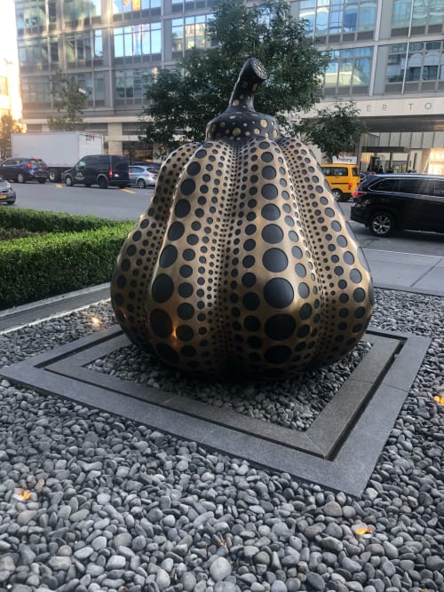 Public Sculptures by Yayoi Kusama seen at Sky - Luxury Apartment Rentals NYC, New York - Brass Pumpkin