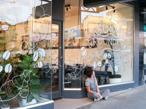Signage by Jess Riley seen at Ampersand Coffee and Food, Thornbury - Glass Mural - Stay Grounded