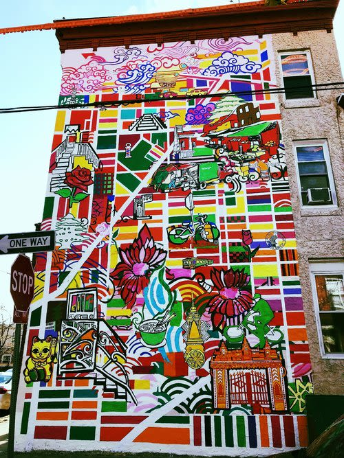 "Street Murals by Shira Walinsky seen at Dickinson Street & South 10th Street, Philadelphia - ""Mapping Migration"""