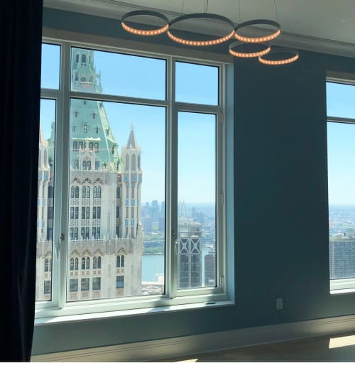 Pendants by Le Deun Luminaires seen at Woolworth Tower Residences, New York - Super 8 Pendant Lights