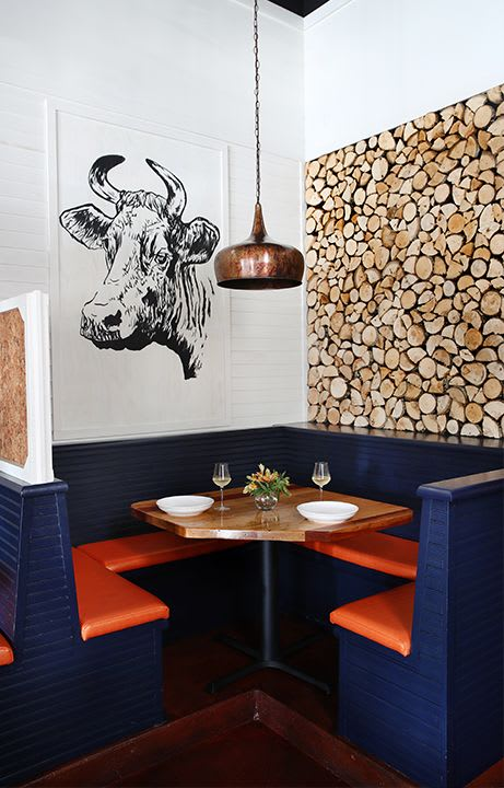 Murals by Julianna Papa seen at Pyre Provisions, Covington - Cow Mural