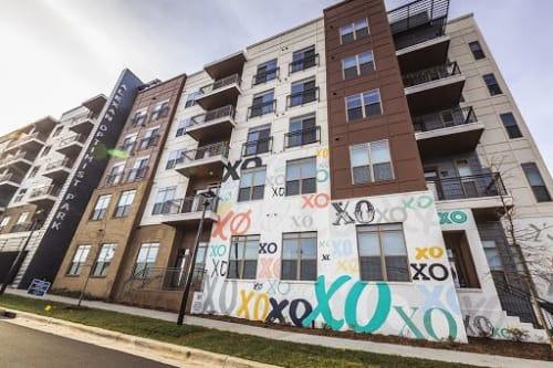 Murals by Kyle Mosher seen at Alexan Optimist Park, Charlotte - XO Wall Mural