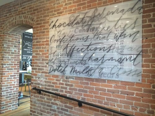 Wall Treatments by Clementine Studio seen at The Charmant Hotel, La Crosse - Script plexiglass painting