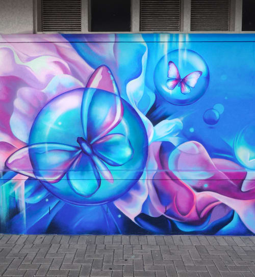 Street Murals by Cheeky Observer seen at Sea Point Promenade, Cape Town - Chrysalis