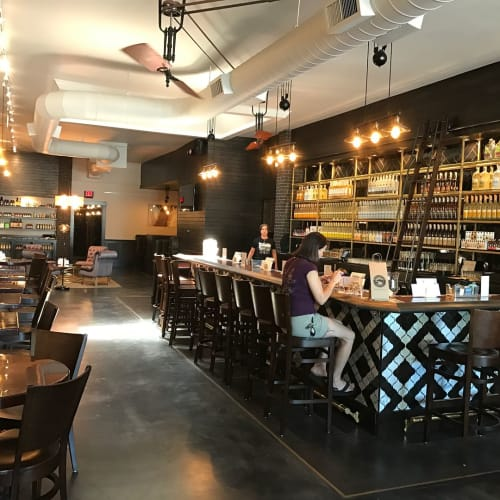Couches & Sofas by Revive Designs and Upholstery seen at Crater Lake Spirits Downtown Tasting Room, Bend - Booth Seating and Leather Bar Top