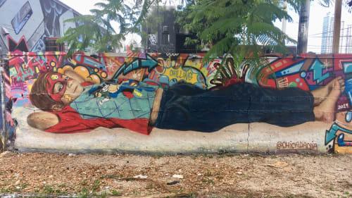 Murals by Chicadania seen at Wynwood Art District, Miami - Ían Lying down in Wynwood