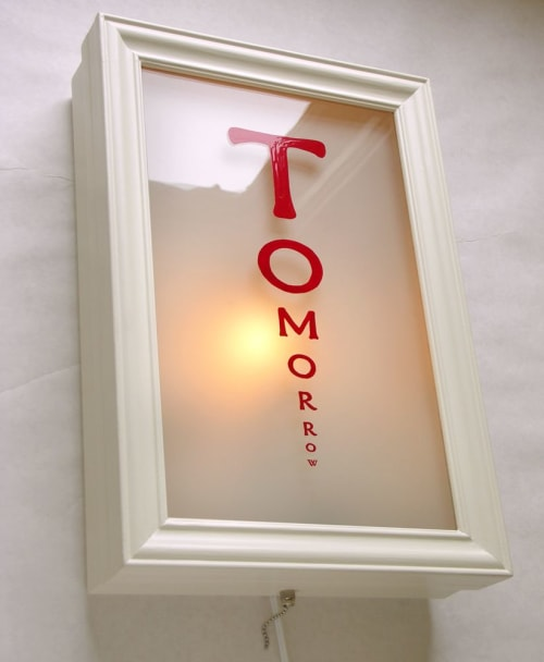 Sconces by Michael Paulus seen at Portland, Portland - Illuminated Eye Charts / Hand-enameled, wall graphics
