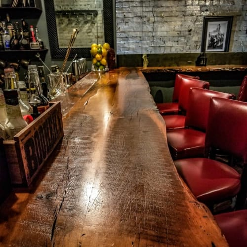 Furniture by naturalDESIGN seen at Red Pony, Franklin - Custom Bar Top and Shelving Unit