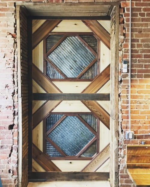 Furniture by Rustic River Creations seen at Rumors Deli, Cullman - Custom Sliding Barn Door