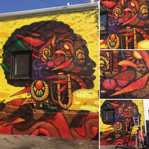 Murals by Visualgoodies seen at Hemingway Building, Kansas City - Mural