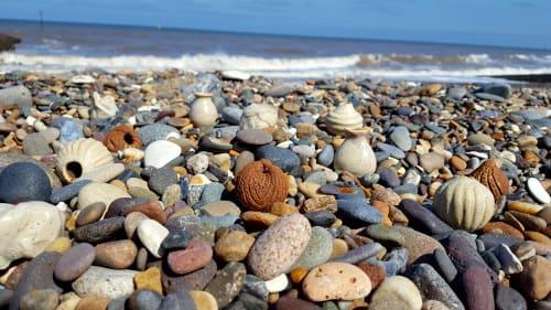 Sculptures by Hannah Billingham seen at Hornsea Beach, Hornsea - Miniature ceramic shell vessels
