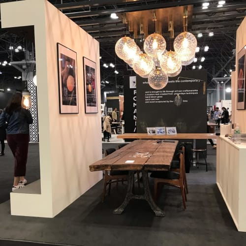 Chandeliers by Embassy interiors seen at New York, New York - Globe Pendants