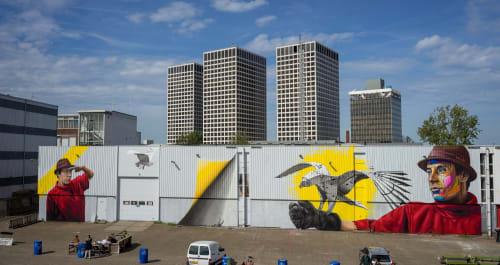 "Street Murals by Nuno Viegas seen at Keilewerf 1, Rotterdam - ""Flight of Man"" - Collaboration with Tymon de Laat"