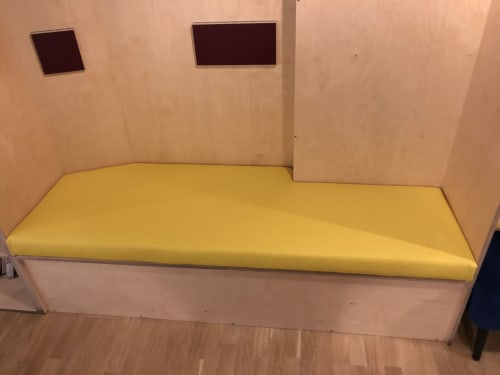 Interior Design by Ray Clarke Upholstery & Design seen at Bow Brew Cafe, London - Bespoke Vinyl seating pad