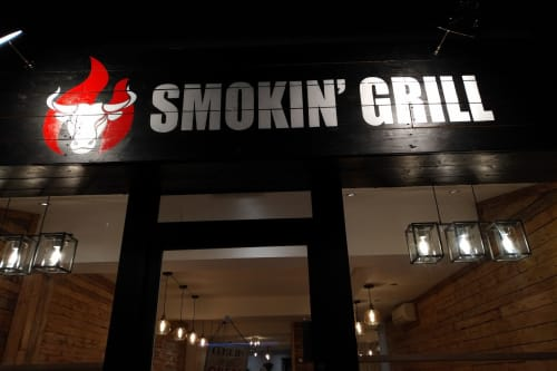 Signage by Heart of Things Studio seen at Smokin Grill Steakhouse & Bar, Worcester Park - Sign Painting