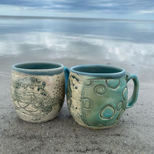 Cups by Tricia Cutler Pottery seen at Frisco, Frisco - Turtle Mug and Jellyfish Mug (soda fired)